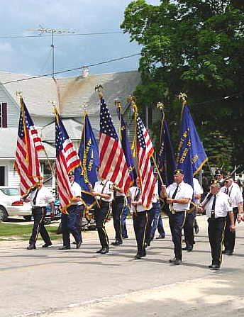 Photo of American Legion group marching in Sweet Corn Days parade in Lime Springs, Iowa.