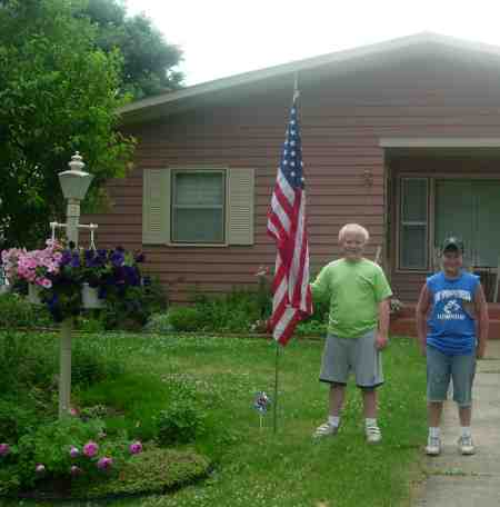 Photo of Junior Community Club members installing American flag.